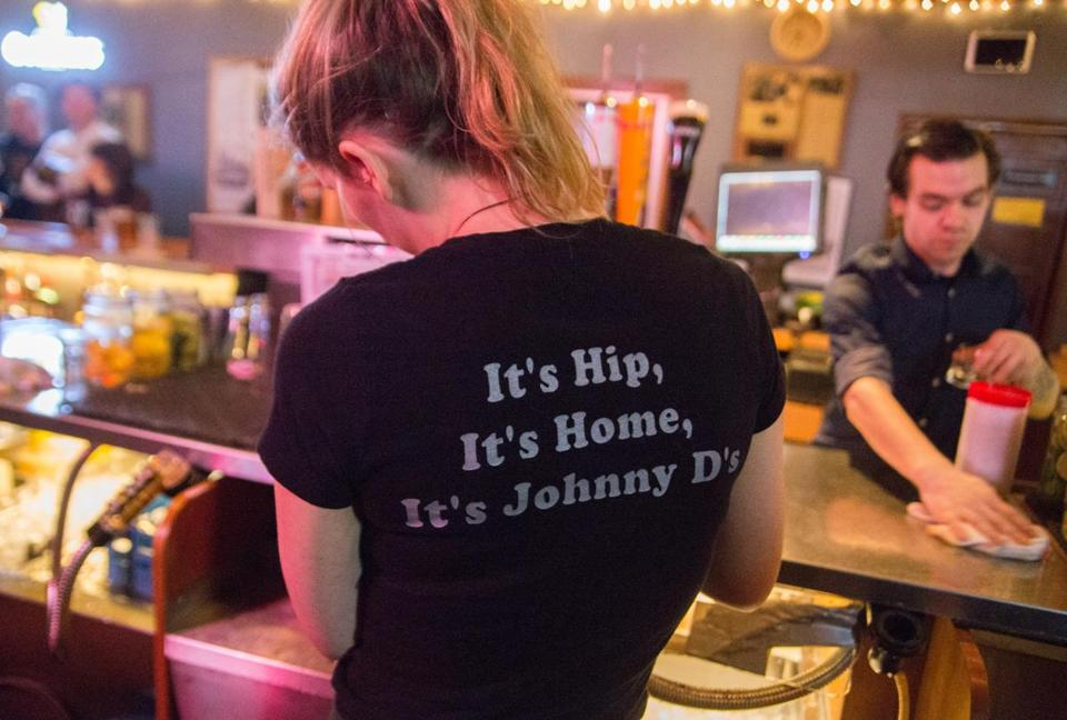A server wearing the classic Johnny D's T-shirt.